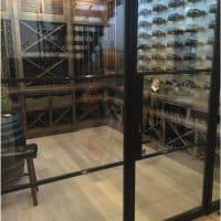 Show off your custom wine cellar with bronze doors.